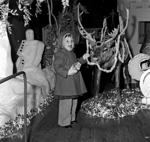 Child meets reindeer at Santa's Grotto in Busbys' Department Store 1957
